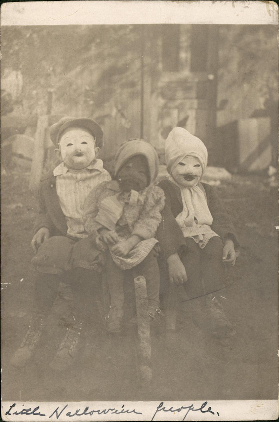 creepy kids wearing creepy old halloween costumes | riot fest